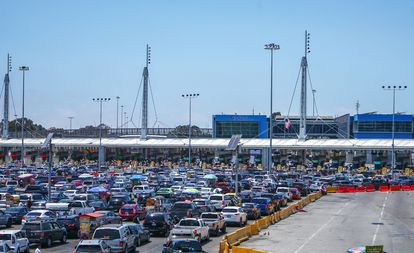 Hundreds of cars wait at the border crossing in the city of Tijuana, on June 14, 2021.