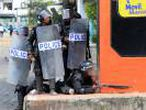A riot police prepares to fire rubber bullets during a protest in Managua