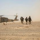 Afghan National Army 215th Corps troops disembark an Afghan Air Force (AAF) Black Hawk helicopter during a troop re-supply at Camp Shorabak in Helmand Province July 28, 2018. Picture taken July 28, 2018. To match Special Report USA-AFGHANISTAN/PILOTS.  U.S. Marine Corps/1st Lt. Kathleen Kochert/Handout via REUTERS THIS IMAGE HAS BEEN SUPPLIED BY A THIRD PARTY.