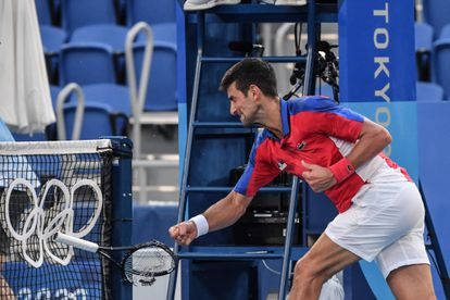 Serbia's Novak Djokovic smashes his racket during his Tokyo 2020 Olympic Games men's singles tennis match for the bronze medal against Spain's Pablo Carreno Busta at the Ariake Tennis Park in Tokyo on July 31, 2021. (Photo by Tiziana FABI / AFP)