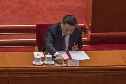 Xi Chinese President Xi Jinping presses the button to vote on the reform of the electoral system in Hong Kong on March 11, 2021.