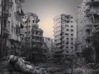 La imagen muestra las ruinas de una ciudad siria con una muñeca en primer plano.