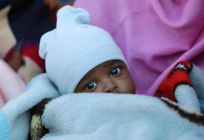 Un niño migrante en uno centro de detención en Bengasi (Libia), el pasado 13 de diciembre.
