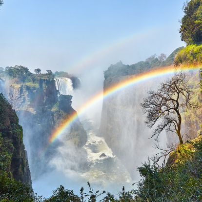 A rainbow appearing over the mighty Victoria Falls, Zimbabwe.