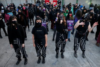 """Members of feminist group Las Tesis, who created the performance piece """"Un violador en tu camino"""" (A rapist in your path), take part in a feminist rally calling for a new Constitution in Valparaiso, Chile, October 14, 2020. REUTERS/Rodrigo Garrido"""