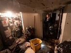 A man who gave his name as John, helps to clean a friend's basement, Friday, Sept. 3, 2021 in the Queens borough of New York. The area was flooded Wednesday as rain from the remnants of Hurricane Ida sent the New York City area into a state of emergency. (AP Photo/Mark Lennihan)