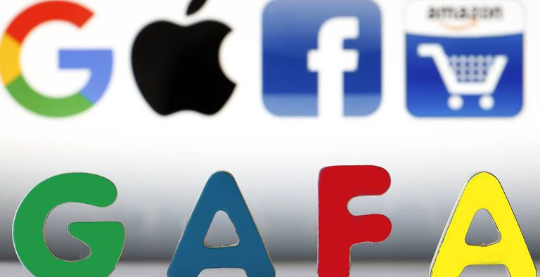 Logos de Google, Apple, Facebook y Amazon sobre el acrónimo GAFA.