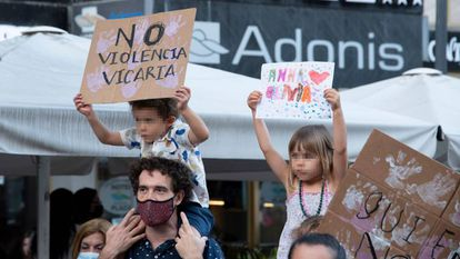 Two children with posters participate in a feminist rally.  EUROPE PRESS