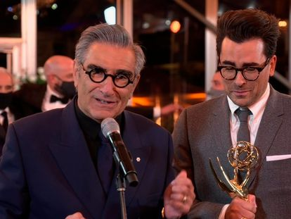 """Eugene Levy, left, and Daniel Levy from """"Schitt's Creek"""" accept the Emmy for Outstanding Comedy Series during the 72nd Emmy Awards telecast on Sunday, Sept. 20, 2020 at 8:00 PM EDT/5:00 PM PDT on ABC. (Invision for the Television Academy/AP) *** Local Caption *** ."""