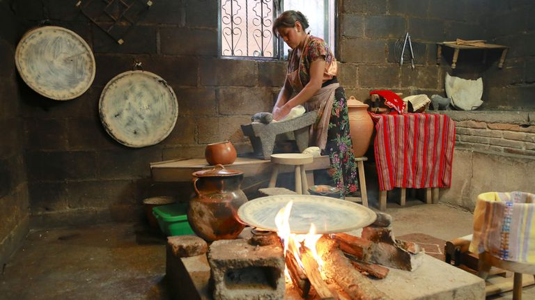 A woman uses firewood to cook in Chiapas, Mexico.