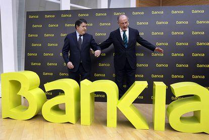 Rodrigo Rato (derecha) y José Luis Olivas, el día de la presentación de Bankia.