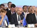 """This handout picture released by the Ukrainian Presidential Press Service on August 23, 2021 , shows European Council President Charles Michel (C) speaking during the Crimean Platform Summit in Kiev. (Photo by - / UKRAINIAN PRESIDENTIAL PRESS SERVICE / AFP) / RESTRICTED TO EDITORIAL USE - MANDATORY CREDIT """"AFP PHOTO / Ukrainian Presidential Press Service"""" - NO MARKETING - NO ADVERTISING CAMPAIGNS - DISTRIBUTED AS A SERVICE TO CLIENTS"""