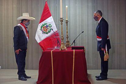 Castillo, left, takes the oath of Pedro Francke as finance minister on Friday night.