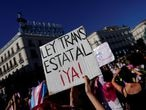 """A person holds a sign reading """"State trans law now!"""" during a demonstration for the rights of transgender people, amid the spread of the coronavirus disease (COVID-19), at Puerta del Sol square in Madrid, Spain, July 4, 2020. REUTERS/Juan Medina"""