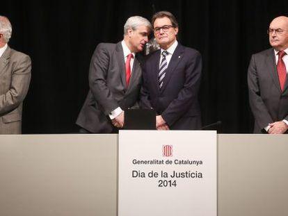 De izquierda a derecha, el fiscal superior de Cataluña, el consejero de Justicia, el presidente de la Generalitat y el presidente del TSJC.