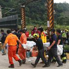 Rescue teams move the body of one of the victims of a train derailment in Taiwan.