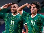 Mexico's Alexis Vega, left, celebrates with teammate Diego Lainez after scoring his side's third goal against Japan in the men's bronze medal soccer match at the 2020 Summer Olympics, Friday, Aug. 6, 2021, in Saitama, Japon. (AP Photo/Martin Mejia)