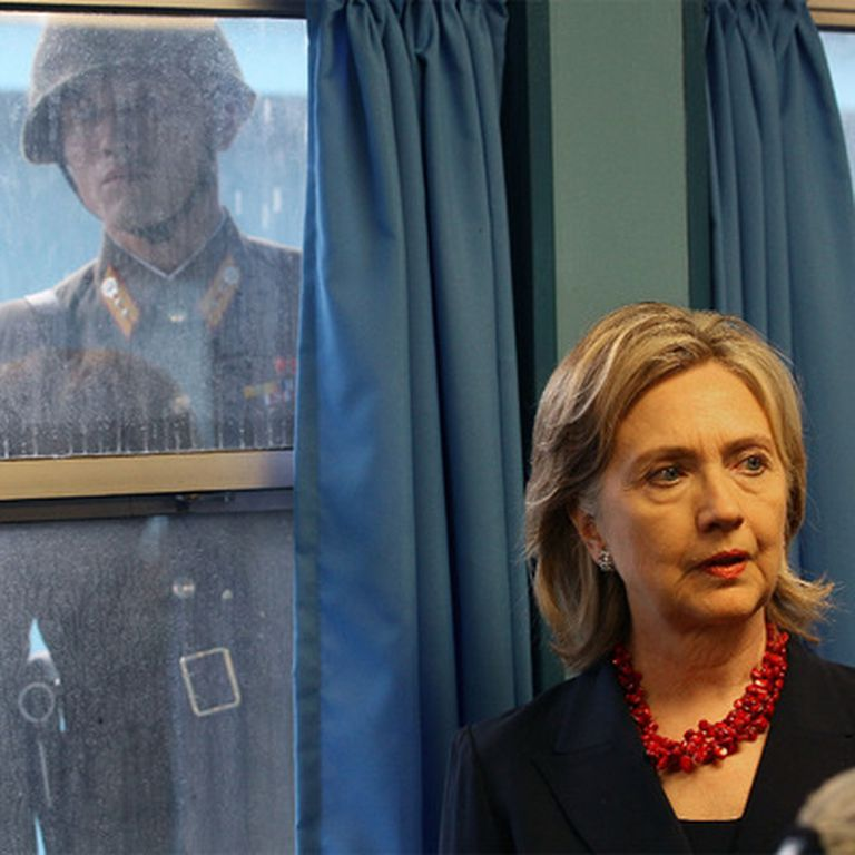 Hillary Clinton in the demilitarized zone between the two Koreas, in the picture a North Korean soldier looks through the glass