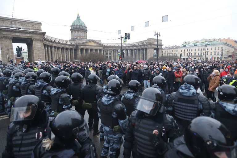 Policemen and protesters during a protest against the arrest of the opposition Alexei Navalni in Saint Petersburg, Russia.