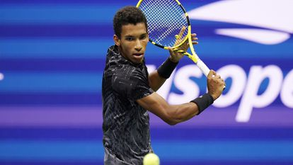 Felix Auger-Aliassime, of Canada, returns to Carlos Alcaraz, of Spain, during the quarterfinals of the U.S. Open tennis tournament Tuesday, Sept. 7, 2021, in New York. (AP Photo/Frank Franklin II)