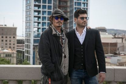 Actor Johnny Depp (left) poses with director Andrew Levitas at the presentation of the film in Barcelona.