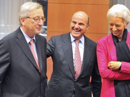 Jean Claude Juncker, Luis de Guindos y Christine Lagarde, antes de la reunión del Eurogrupo.