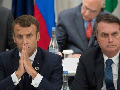 El presidente francés, Emmanuel Macron, y el presidente de Brasil, Jair Bolsonaro durante la cumbre del G20 en Osaka en junio pasado.