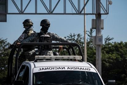 Elements of the National Guard, during a patrol.