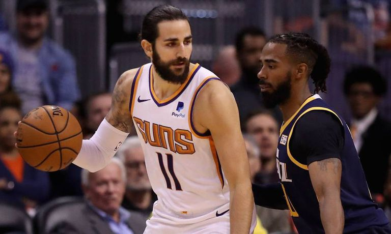 Ricky Rubio and Mike Conley, in a game between Phoenix and Utah.