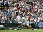 Tennis - Wimbledon - All England Lawn Tennis and Croquet Club, London, Britain - July 5, 2021 Serbia's Novak Djokovic in action during his fourth round match against Chile's Cristian Garin REUTERS/Paul Childs