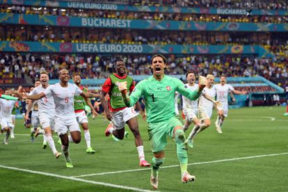 Swiss goalkeeper Yann Sommer celebrates the move to the quarterfinals after stopping Mbappé's penalty.