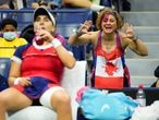 Sep 6, 2021; Flushing, NY, USA; Bianca Andreescu of Canada (left) takes a drink during a change as fans cheer her on in the third set against Maria Sakkari of Greece on day eight of the 2021 U.S. Open tennis tournament at USTA Billie Jean King National Tennis Center. Mandatory Credit: Robert Deutsch-USA TODAY Sports