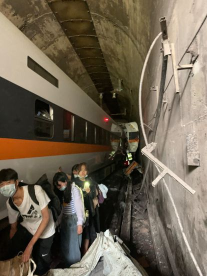 Inside the tunnel in which the train has partially derailed.