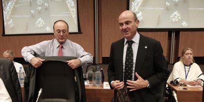 Linde (izquierda) y Guindos, en el Ecofin.