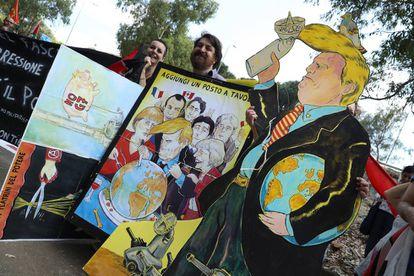 Manifestantes anti Trump ante la cumbre del G7.