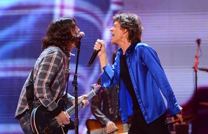 Dave Grohl and Mick Jagger at a Rolling Stones concert in 2013.