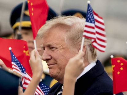 Trump, este miércoles a su llegada a China.