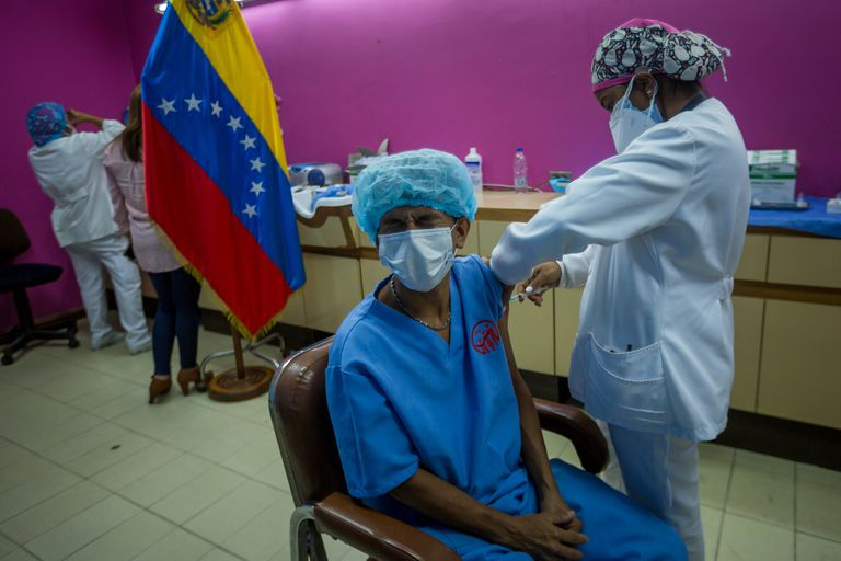 Workers of the Domingo Luciani hospital participate in a vaccination day against covid-19 with doses of the Russian Sputnik V, on March 4, in Caracas.