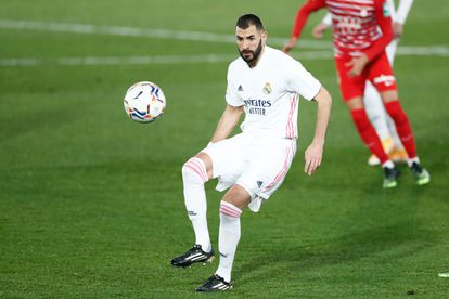 Benzema controls the ball during the first round match between Real Madrid and Granada.