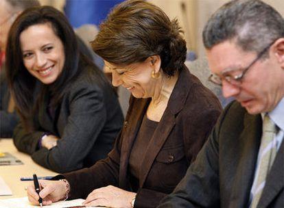 La ministra de Vivienda, la de Fomento y el alcalde de Madrid.